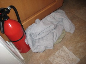 The sweatshirt appeared last night, but the fire extinguisher has been there for weeks (months?). I am not certain whether this is its temporary location or whether it even works.