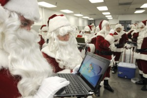 Santas looking at Windows on laptop