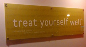 Treat Yourself Well sign